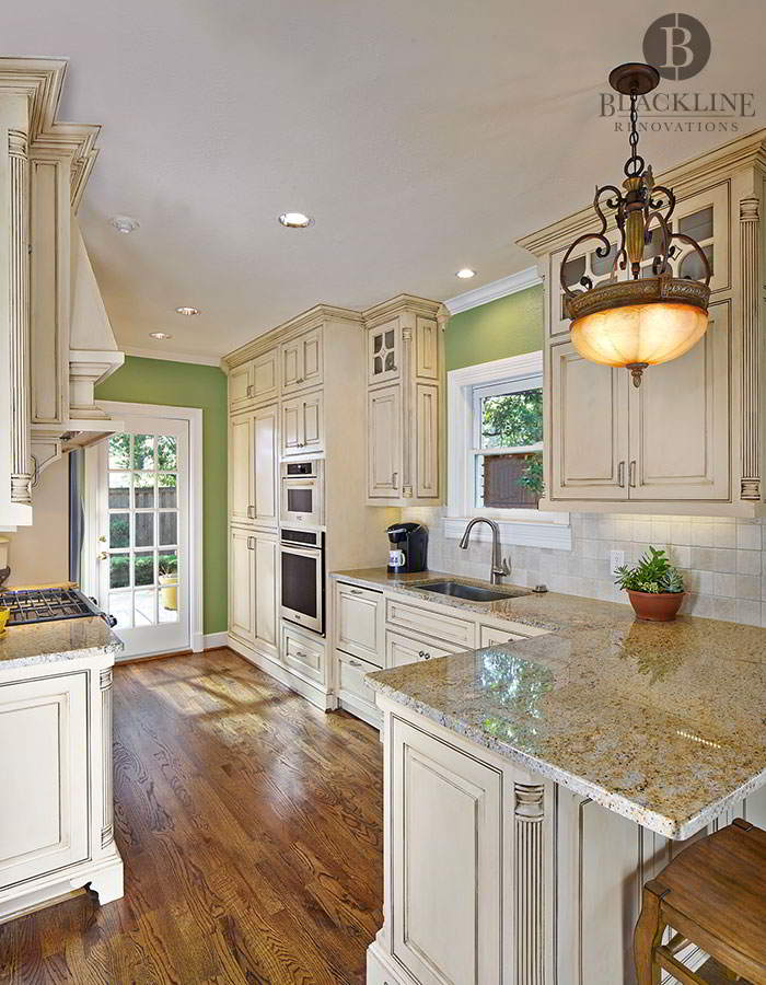 Green Kitchen with Wood Flooring in M-Streets Dallas