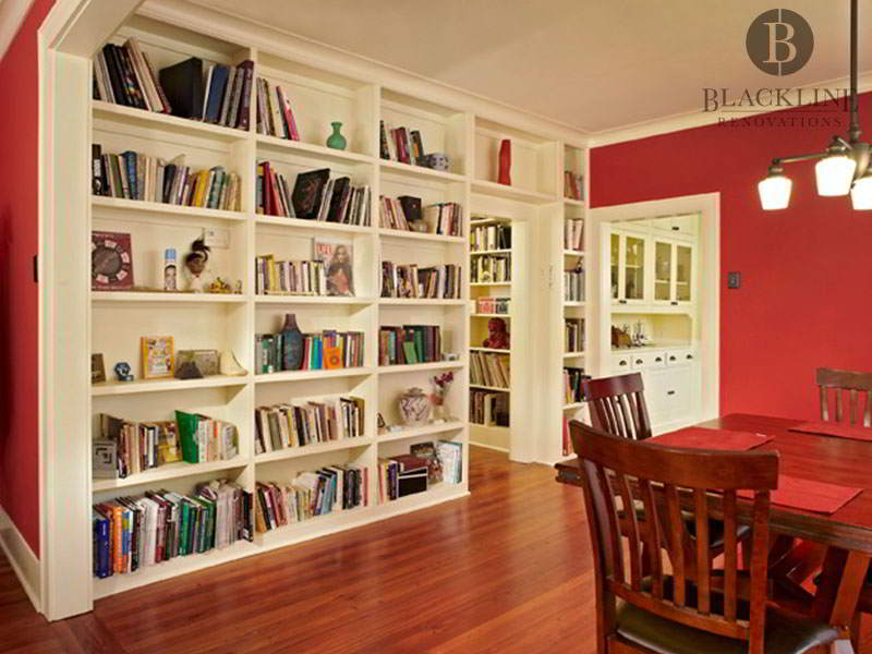 Dallas, Texas bungalow in Vickery Place features built-in bookshelves and wood flooring in dining room.